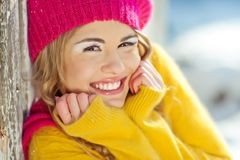 Girl in the fall dressed yellow. And violet cap with hugging hands Royalty Free Stock Image