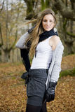Girl fall forest. Beautiful young fashion woman posing in an autumn forest Royalty Free Stock Image