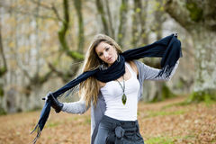 Girl fall forest. Beautiful young fashion woman posing in an autumn forest Royalty Free Stock Photo