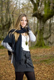Girl fall forest. Beautiful young fashion woman posing in an autumn forest Royalty Free Stock Images