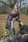 Girl fall forest. Beautiful young fashion woman posing in an autumn forest Stock Photography