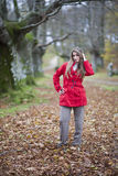 Girl fall forest. Beautiful young fashion woman posing in an autumn forest Stock Images