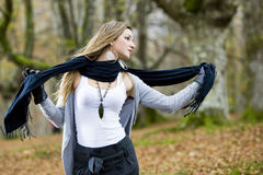 Girl fall forest. Beautiful young fashion woman posing in an autumn forest Stock Image