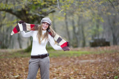 Girl fall forest. Beautiful young fashion woman posing in an autumn forest Royalty Free Stock Photos