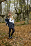 Girl fall forest. Beautiful young fashion woman posing in an autumn forest Stock Photo