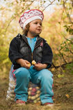 Girl in the fall garden Stock Photography