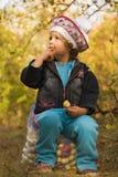 Girl in the fall garden Stock Photo