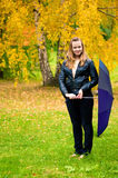 Girl in fall park Stock Image