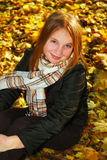 Girl in a fall park Stock Images