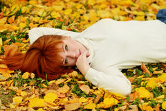 Girl in fall park Royalty Free Stock Photo