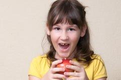 Girl fallen her tooth. Girl fallen her milk-tooth in the apple Stock Photos