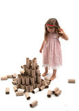 Girl and fallen paper rolls tower Stock Image