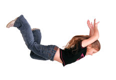 Girl falling. Young caucasian girl falling isolated on white Stock Image