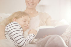 Girl falling asleep while reading book Royalty Free Stock Image