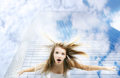 Girl falling down from skyscraper Stock Image