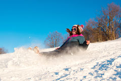 Girl falling down on the snow Stock Images