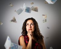 Girl and Euro. Girl and falling Euro banknotes. Currency and lottery concept. Young woman is doing something Stock Photos