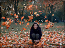 Girl and falling leafs Stock Image