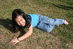 Girl falling off. Little girl falling off at the park on sunny day Royalty Free Stock Photography
