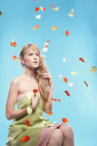 Girl in falling petals Stock Photography