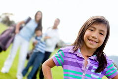 Girl and family playing golf Stock Photos