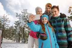 Girl with family taking selfie together in mountain Royalty Free Stock Image