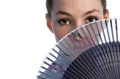 Girl with fan 1. White girl with fan on the white background royalty free stock photo