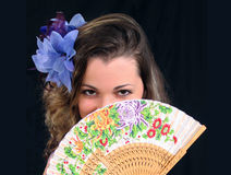 The girl with a fan. The girl covers with a fan half of person Royalty Free Stock Photography