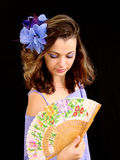 The girl with a fan. Looks downwards Stock Photo
