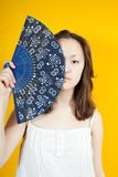 Girl and  fan Royalty Free Stock Photo