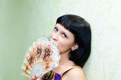 Girl and fan royalty free stock photography