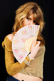 A girl with a fan Stock Photos