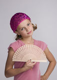 A Girl and and A Fan Royalty Free Stock Photography