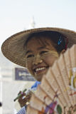 Girl with a fan. Burmese girl smiling Royalty Free Stock Image