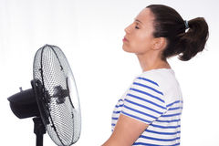 Girl and fan. Royalty Free Stock Images