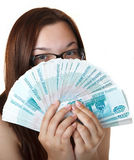 Girl with Fan of denominations. Royalty Free Stock Photo