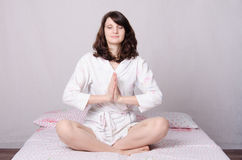 Girl fan direction yoga Stock Photography