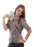 Girl with fan of dollar. Young girl holding a fan of American dollar bills Royalty Free Stock Photos