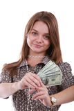 Girl with fan of dollar. Young girl holding a fan of American dollar bills Royalty Free Stock Photo