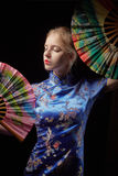 Girl with fan Royalty Free Stock Photo