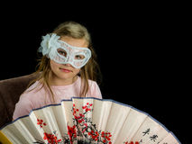 Girl with fan and mask in dress Royalty Free Stock Photo