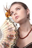 Girl with fan poses on white Stock Photo
