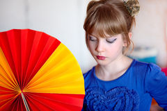 Girl with fan Stock Images