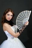 Girl with fan in white dress Royalty Free Stock Image