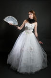 Girl with fan in white dress Royalty Free Stock Photo