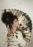 The girl with Fan Royalty Free Stock Photo