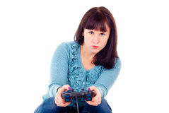 The girl fanatically plays in the video game Royalty Free Stock Photo