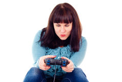 The girl fanatically plays in the video game Stock Photography