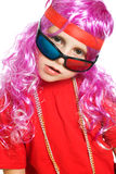 A girl in fancy clothes and 3d glasses Stock Photography