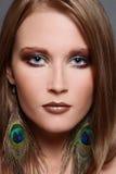 Girl in fancy earrings stock images